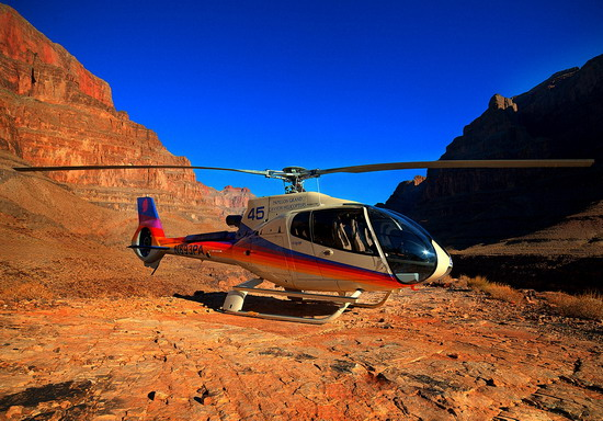 helicopter landing on bottom of grand canyon